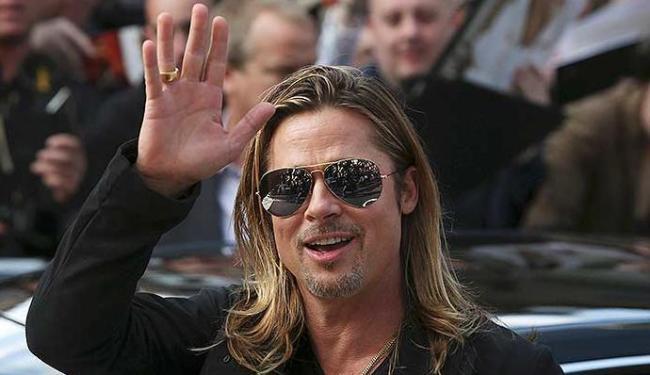 Brad Pitt acompanha os protestos no Brasil pela mídia internacional - Foto: Ag. Reuters