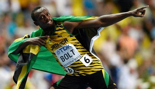 Jamaicano comemora a vitória nos 100m com seu tradicional raio - Foto: Dylan Martinez l Reuters