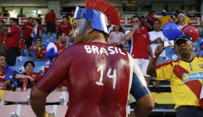 Torcedor de Costa Rica comemora classificação para a Copa do Mundo no Brasil - Foto: Gilbert Bellamy / Agência Reuters