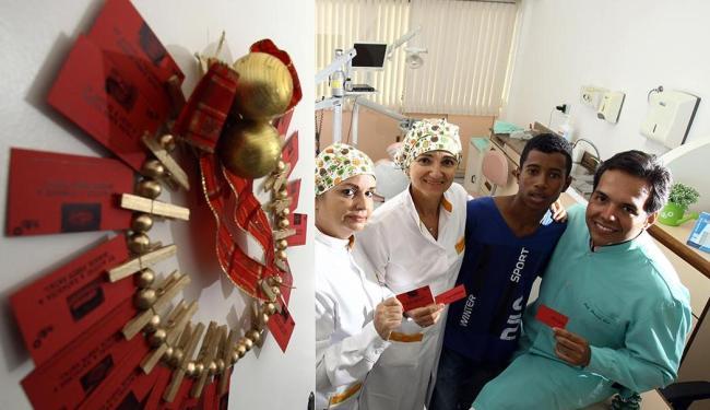 Guirlanda de fotos de dentições simbolizam assistência a pacientes como Bruno de Jesus (de azul) - Foto: Lúcio Távora   Ag. A TARDE