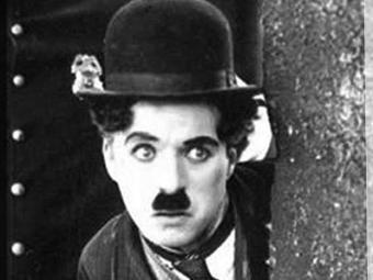 Chaplin como o repórter em Ganhando a Vida - Foto: Reprodução