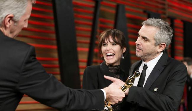 Diretor Alfonso Cuarón (D) escolhido Melhor Diretor por Gravidade - Foto: Danny Moloshok | Reuters