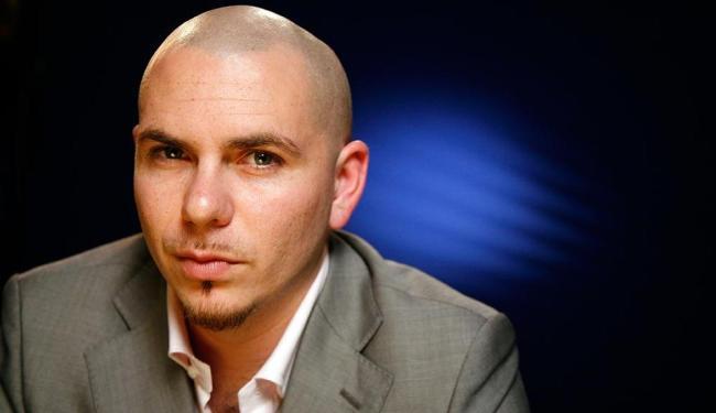 O cantor Pitbull possui nove álbuns lançados - Foto: AP   Jeff Christensen