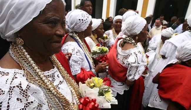 A festa mistura candomblé e catolicismo em quatro dias de cerimônias - Foto: Raul Spinassé | Ag. A TARDE