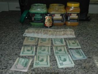 Venezuelano escondeu as drogas em potes de creme para a pele - Foto: Divulgação   Polícia Federal