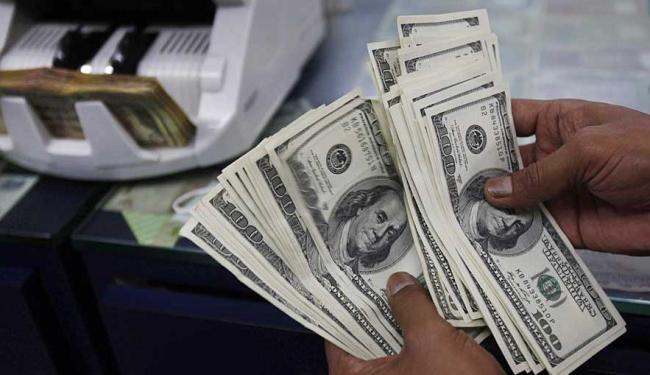 Dúvidas dos investidores sobre a política cambial para 2015 mantêm a oscilação - Foto: Aijaz Rahi | AP Photo