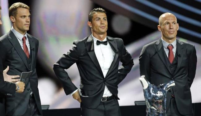 Neuer (E) Cristiano Ronaldo (C) e Robben figuram a seleção da Uefa de 2014 - Foto: Eric Gaillard | Ag. Reuters