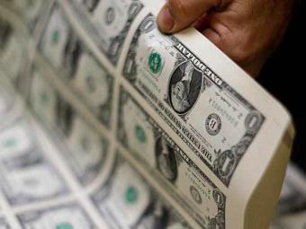 Só nos últimos sete dias, o dólar subiu quase 7% em relação à moeda brasileira - Foto: Gary Cameron | Agência Reuters