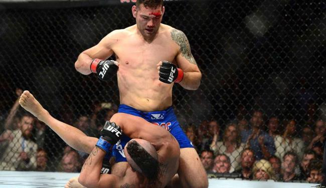 Chris Weidman venceu Vitor Belfort por nocaute técnico aos 2min53s do primeiro round - Foto: Joe Camporeale | USA Today Sports