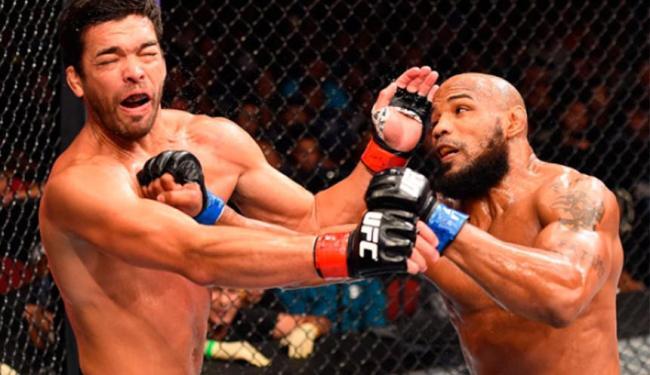 Machida não conseguiu reagir a sequência de golpes de cubano - Foto: Divulgação | UFC