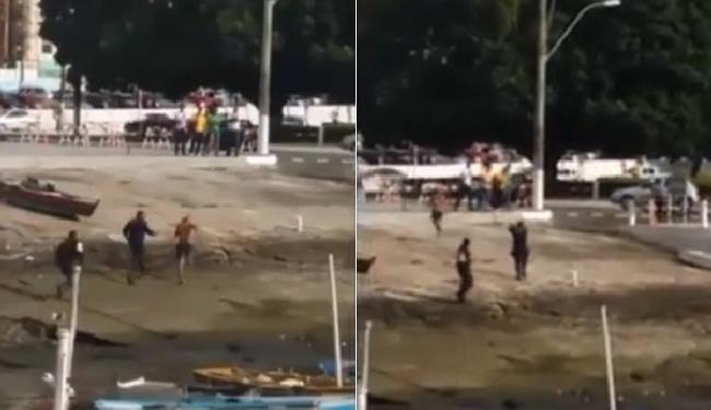 Trecho do vídeo mostra a perseguição, seguida do tiro. Duas pistolas foram encaminhadas à perícia - Foto: Reprodução l YouTube