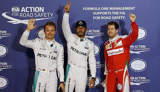 Rosberg, Hamilton e Vettel comemoram as posições no grid - Foto: Hamad I Mohammed   Reuters