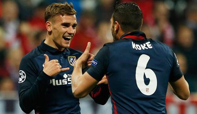 Griezmann (D) marcou o gol que garantiu a classificação do Atlético - Foto: Michaela Rehle Livepic l Reuters
