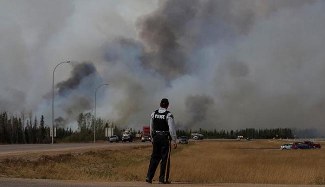 Há temor de que o fogo dobre de tamanho e atinja uma das maiores minas da região, em Saskatchewan - Foto: Mark Blinch | Ag. R euters