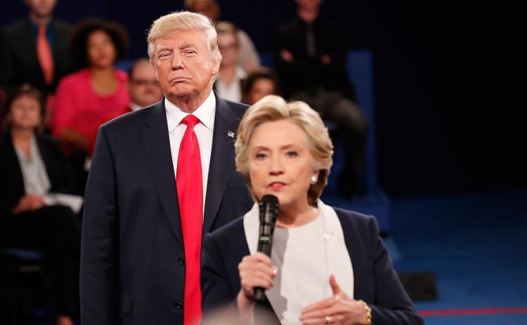 Hillary Clinton e Trump durante debate - Foto: Rick Wilking l Reuters