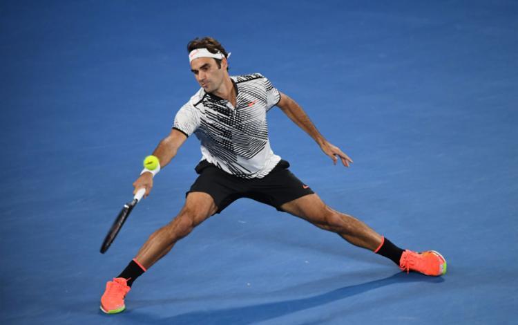 Federer precisou de 5 sets pra despachar o compatriota Wawrinka - Foto: Saeed Khan | AFP