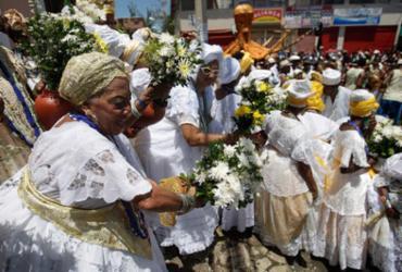 Lavagem lota as ruas de Itapuã | Foto: Raul Spinassé l Ag. A TARDE