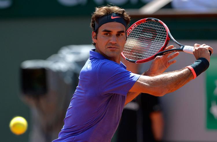 Tenista suíço optou por priorizar a temporada de grama e de quadras duras - Foto: Miguel Medina l AFP