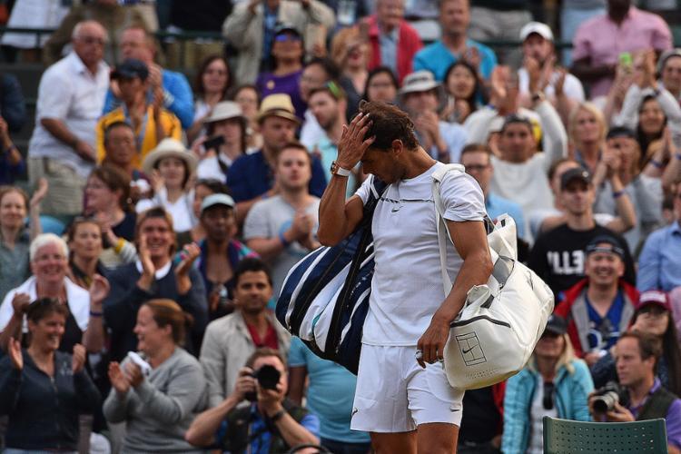 Nadal não consegue passar das oitavas de final em Wimbledon desde 2011 - Foto: Glyn Kirk l AFP