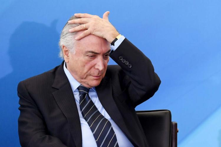 A maioria dos brasileiros acredita que Temer não está enfrentando os problemas do País - Foto: Evaristo Sá | AFP