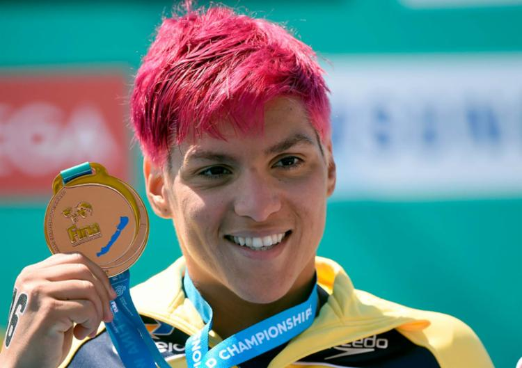 Ana Marcela assegurou a medalha de bronze com o tempo de 59min11s40 - Foto: Attila Kisbenedek | AFP
