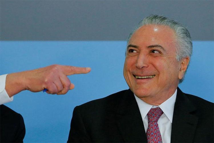 Deputados aprovaram parecer que defendia o arquivamento da denúncia contra Temer - Foto: Sérgio Lima | AFP