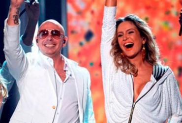 Após passar mal, Pitbull confirma presença no trio de Claudia Leitte | AFP