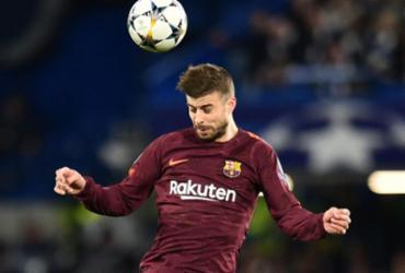 Recuperado de dores, Piqué é relacionado no Barcelona para jogo de sábado   Glyn Kirk   AFP