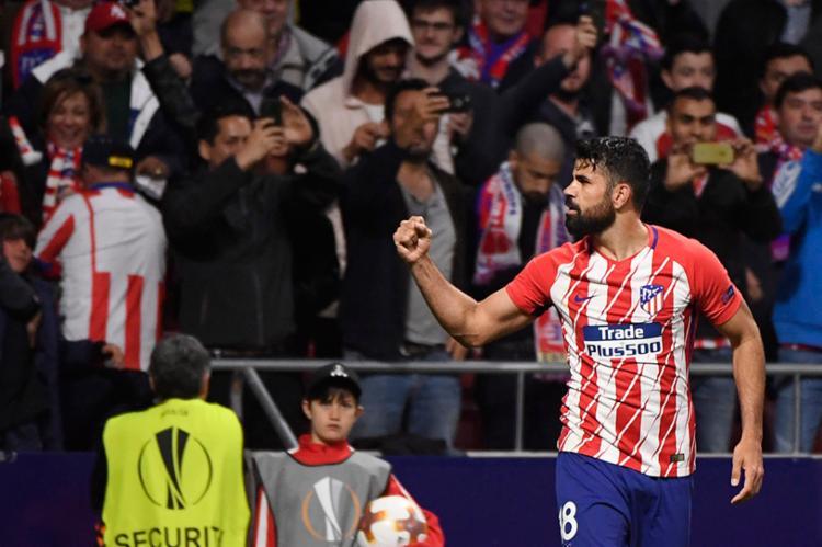 O atacante espanhol comemora ao fazer o gol da classificação do Atlético - Foto: Pierre Philippe Marcou | AFP