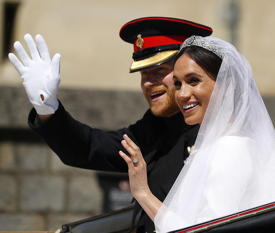 Harry e Markle agora podem ser chamados de duque e duquesa de Sussex | Phil Noble | AFP
