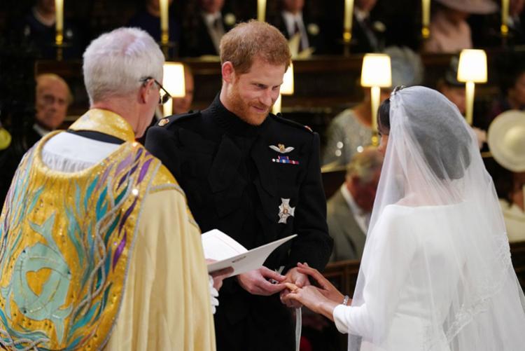 O arcebispo de Canterbury, Junstin Welby, declarou Harry e Meghan marido e mulher | Jonathan Brady | AFP