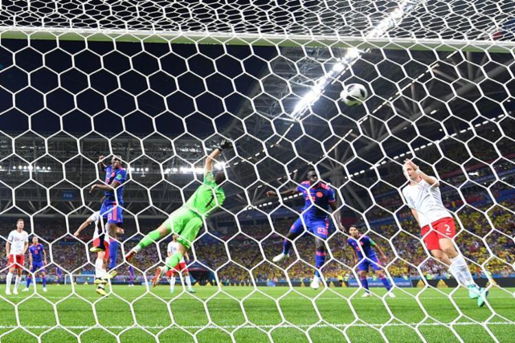 Com gols de Yerry Mina, Falcao e Cuadrado, Colômbia garante boa pontuação no grupo H - Foto: AFP
