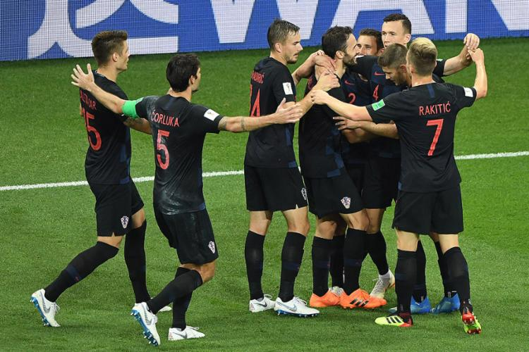 Jogadores croatas comemora o segundo gol - Foto: Khaled Desouki l AFP