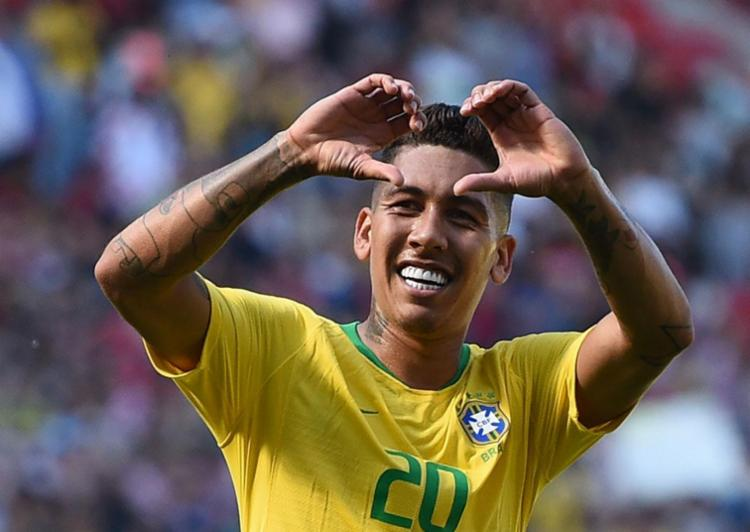 Firmino fez segundo gol do Brasil - Foto: Oli Scarff | AFP