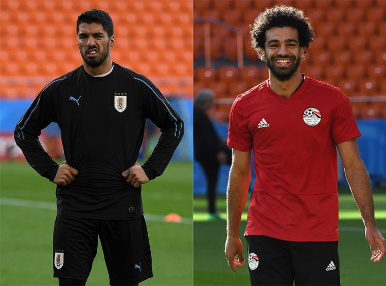 Suárez e Salah farão um bom duelo de matadores - Foto: Jorge Guerrero e Anne-Christine Poujoulat l AFP