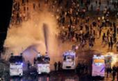 Lojas em Paris são saqueadas durante festejos pelo título da França na Copa | Foto: AFP