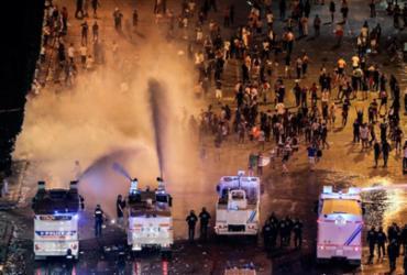 Lojas em Paris são saqueadas durante festejos pelo título da França na Copa | AFP