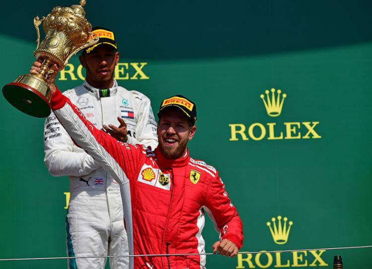 Esse foi 51.º triunfo da carreira de Vettel, sendo o quarto na temporada - Foto: Andrej Isakovic l AFP