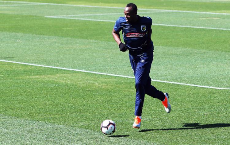 Treinador disse que Bolt pode atrapalhar o desenvolvimento de jovens jogadores australianos - Foto: Peter Lorimer | AFP