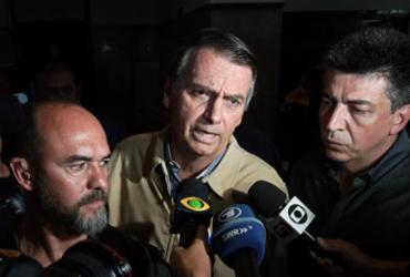 'Eu já adverti o garoto', diz Bolsonaro sobre fala de seu filho | Carl de Souza l AFP