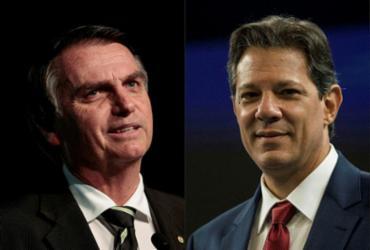 Bolsonaro tem 57% dos votos válidos, contra 43% de Haddad | AFP