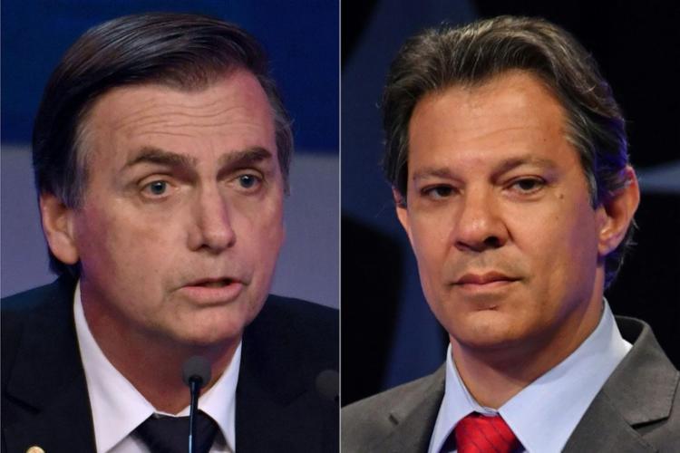 Candidato do PSL oscila dois pontos porcentuais para baixo e vantagem para petista cai de 18 para 14 pontos - Foto: Nelson Almeida l AFP