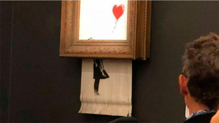 Obra 'Menina com Balão' foi triturada após leilão em Paris, na última sexta - Foto: Shotby's l The New York Times