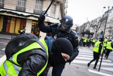 França: ministro contabiliza mais de 130 feridos em protestos de Paris | Alain Jocard l AFP