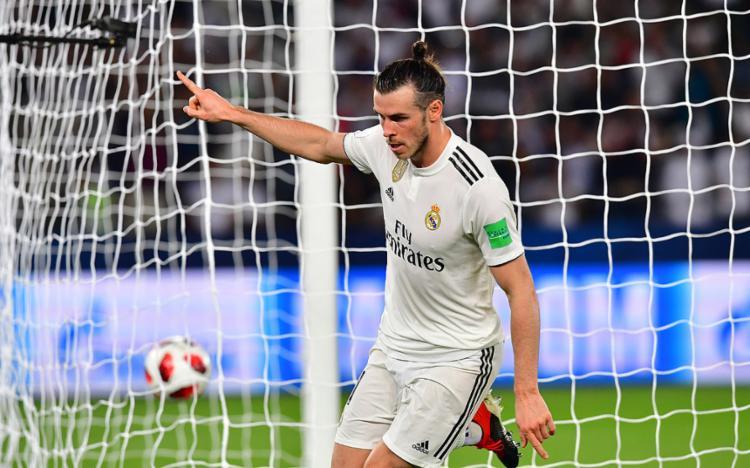 O time espanhol contou com uma atuação de gala de Bale para bater a equipe japonesa por 3 a 1 - Foto: Giuseppe Cacace l AFP