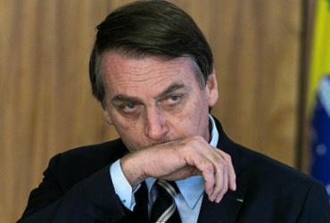 Bolsonaro critica lei trabalhista e diz que Brasil deve beirar a informalidade | Sergio Lima | AFP