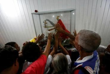 Devotos participam de missa e procissão em homenagem a São Jorge |