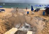 Água da chuva leva sujeira para a praia do Porto da Barra | Foto: Raul Spinassé | Ag. A TARDE