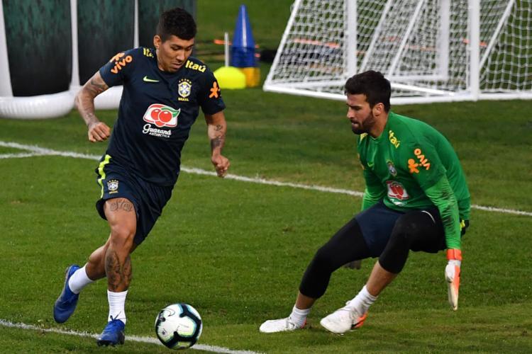 Firmino deve formar o trio ofensivo com David Neres e Richarlison - Foto: Nelson Almeida l AFP