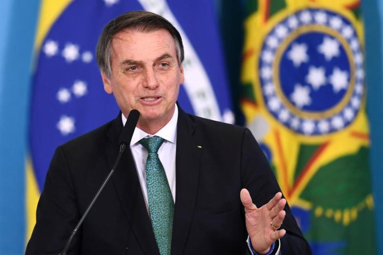 Presidente estava rodeado de lideranças religiosas e políticos - Foto: Evaristo Sa | AFP